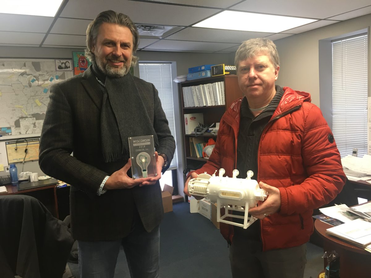 Ludek (COO) and Charles (CTO) hold the award and 3D model of a CORNCOB II unit